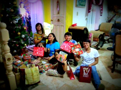 December. Opening up their presents.